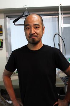 代表の小村富雄さん。